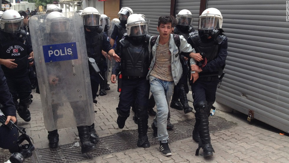 """CNN's Ivan Watson says this picture shows one of at least half a dozen people detained by Turkish police in Istanbul's Besiktas neighborhood. """"Some protesters have been throwing rocks and bottles and shooting fireworks at police, who respond with plastic pellets, water cannons and copious amounts of tear gas,"""" he says."""