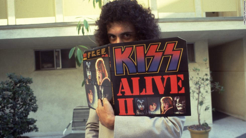 "The band's chart success was based on constant and energetic touring -- concerts that were then turned into some best-selling live albums. In 1977, the band released ""KISS Alive II,"" displayed here by a coy Simmons."