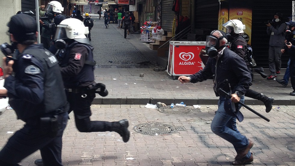 "Police charge along the streets. ""The sad thing is, in 2012 the Turkish government allowed labor unions and leftist parties to hold a rally in Istanbul's Taksim Square,"" says Watson. ""That was a peaceful May Day attended by tens of thousands. For the last two years, the state has banned rallies there and the result has been violence, riots and police crackdown."""