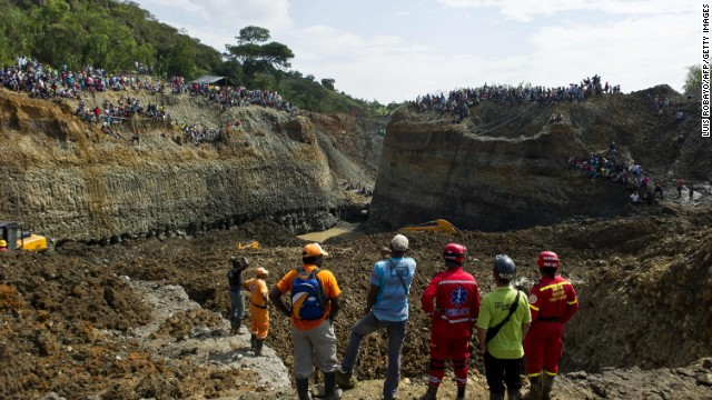 Rescuers work on the removal of sludge during the rescue of a group of miners in a gold mine that collapsed in San Antonio, rural area of Santander de Quilichao, department of Cauca, Colombia, on May 1, 2014, where independent mine workers were excavating the mine without authorization. At least three people were killed and as many as 30 more are feared dead after a mine collapse in western Colombia, rescue officials said on Thursday. 'We arrived at the scene and managed to remove three bodies,' said Victor Claros, head of the firefighters in the Colombia's Cauca state, where the disaster took place. Colombia has more than 14,000 mines, more than half of which operate without proper permits, officials said. AFP PHOTO/Luis Robayo (Photo credit should read LUIS ROBAYO/AFP/Getty Images)