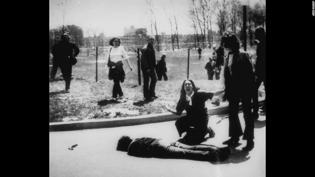 Four students died and nine others were wounded on May 4, 1970, when members of the Ohio National Guard opened fire on students protesting the Vietnam War at Kent State University in Ohio. In this Pulitzer Prize-winning photo, taken by Kent State photojournalism student John Filo, Mary Ann Vecchio can be seen screaming as she kneels by the body of a slain student.