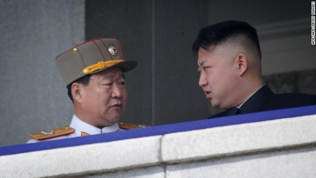 A man believed to be Choe Ryong-Hae (L) talks to North Korean leader Kim Jong-Un (R) whilst attending a military parade in Pyongyang on April 15, 2012.