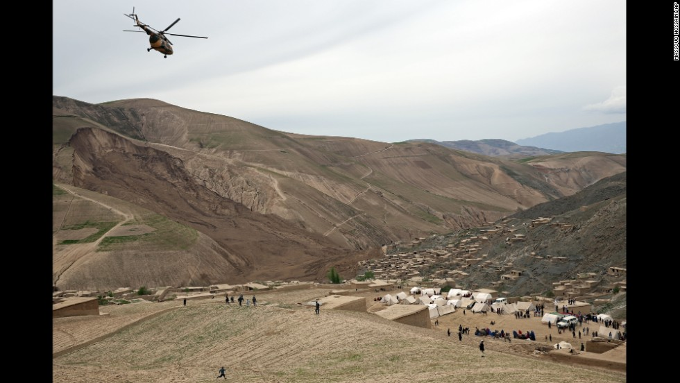 A helicopter flies over survivors on May 4.
