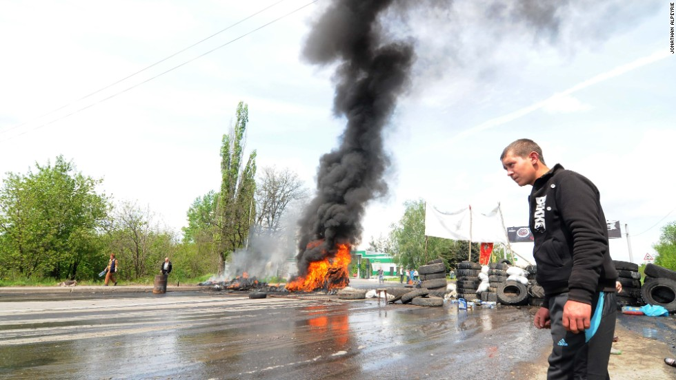 A man walks past burning tires near Kramatorsk on May 3.
