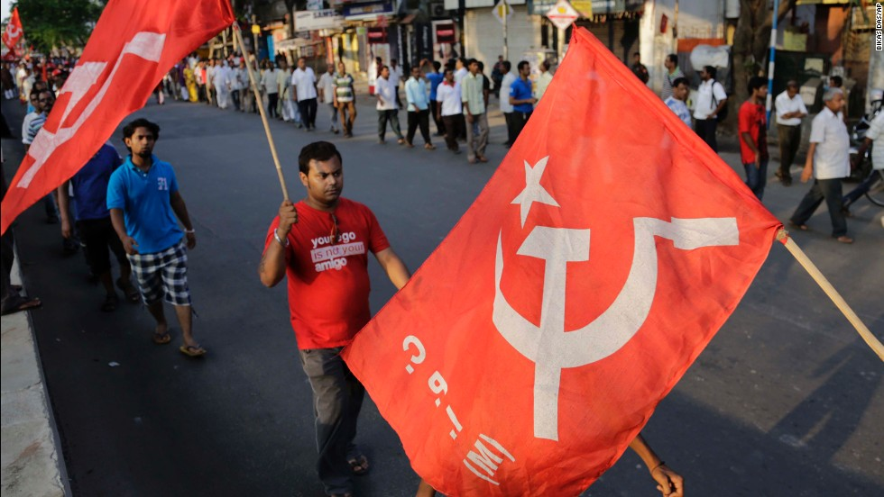Supporters of the Communist Party of India (Marxist) walk with party flags during an election campaign in Kolkata on Sunday, May 4.