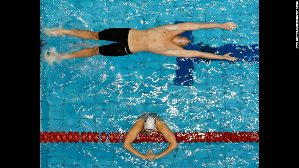 Nicolas Graesser, top, starts a 100-meter backstroke heat on Sunday, May 4, during the German Swimming Championships in Berlin.