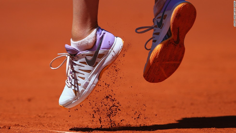 Pro tennis player Maria Sharapova jumps to deliver a serve during the Madrid Open on Sunday, May 4. She beat Klara Koukalova 6-1, 6-2 in the first-round match.