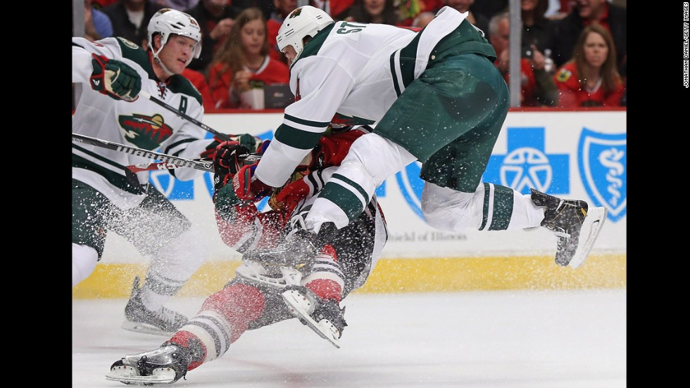 Clayton Stoner of the Minnesota Wild, right, knocks down Ben Smith of the Chicago Blackhawks on Sunday, May 4, in Game 2 of their NHL playoff series. Chicago won the home game 4-1 to take a 2-0 lead in the best-of-seven series.
