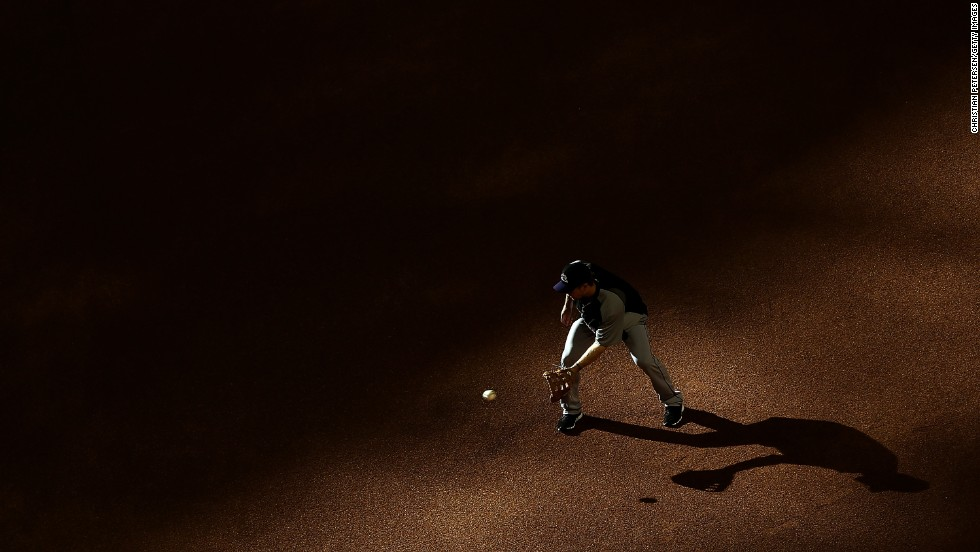 Justin Morneau of the Colorado Rockies fields a ground ball as he warms up for a Major League Baseball game against the Arizona Diamondbacks on Wednesday, April 30, in Phoenix.