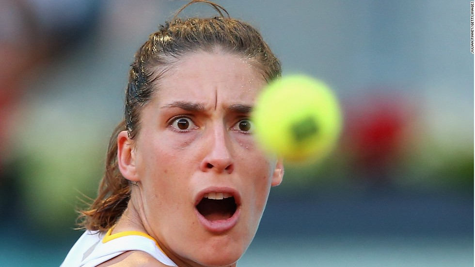 Andrea Petkovic focuses on the tennis ball during her first-round match in the Madrid Open on Saturday, May 3. She lost to Sara Errani in straight sets.