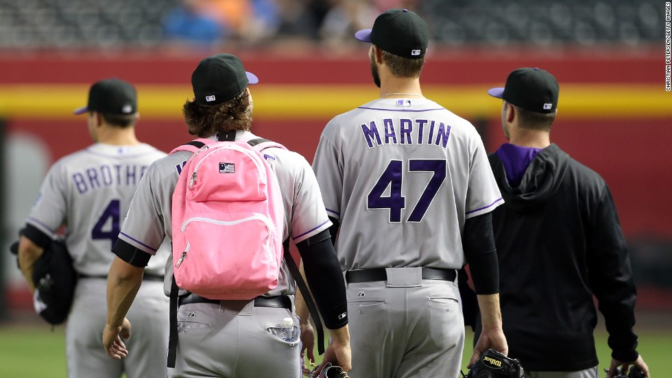 Tommy Kahnle, a rookie pitcher with the Colorado Rockies, wears a pink backpack as he walks to the bullpen before a Major League Baseball game against the Arizona Diamondbacks on Wednesday, April 30.