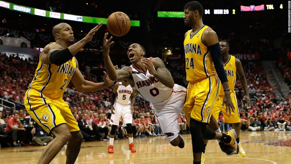 Atlanta point guard Jeff Teague, center, is fouled by Indiana's Paul George, right, during Game 6 of their NBA playoff series Thursday, May 1, in Atlanta. The Pacers, the No. 1 seed in the Eastern Conference, would go on to win the game and the series.