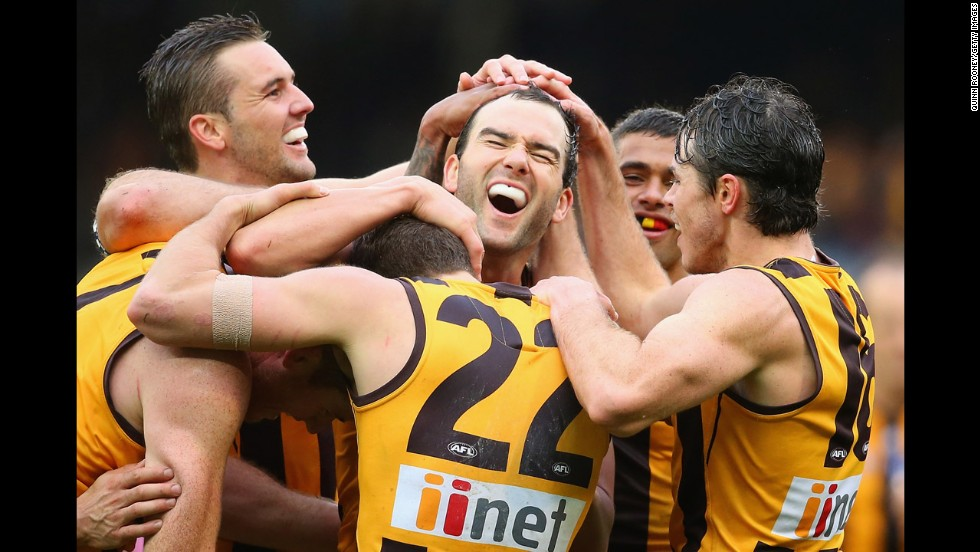 Jordan Lewis of the Hawthorn Hawks is congratulated by teammates after kicking a goal against the St. Kilda Saints during an Australian Football League match won by the Hawks on Saturday, May 3, in Melbourne. It was Lewis' 200th match with the team.