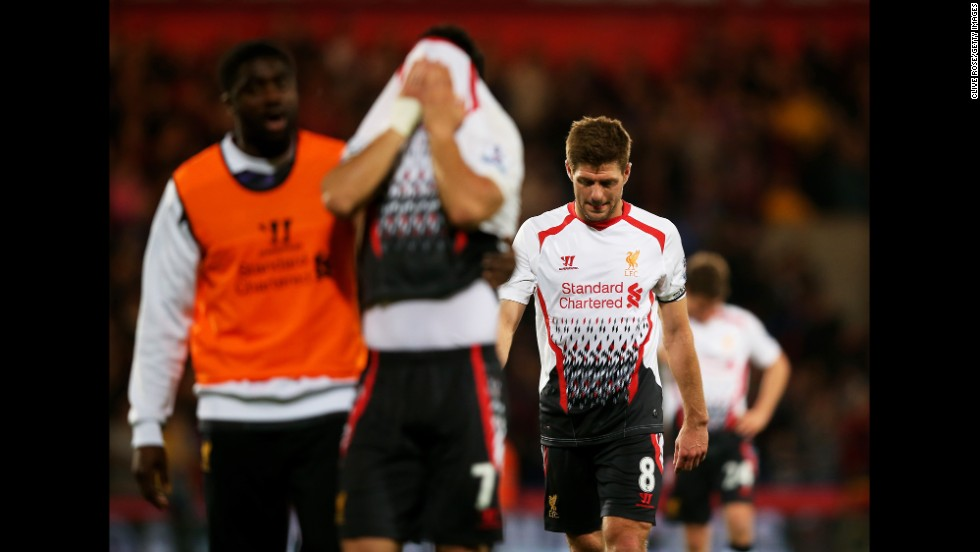 """A dejected Steven Gerrard of Liverpool walks off the pitch following his team's 3-3 draw against Crystal Palace in London on Monday, May 5. The result means Manchester City is now the favorite to win the Premier League title. <a href=""""http://www.cnn.com/2014/04/29/worldsport/gallery/what-a-shot-0429/index.html"""">See 37 amazing sports photos from last week</a>"""