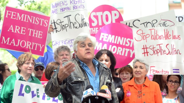 Jay Leno speaks at a protest across from the Beverly Hills Hotel, owned by the Sultan of Brunei, demanding he rescind Brunei's adoption of sharia law, on May 5 2014 in Beverly Hills, California.