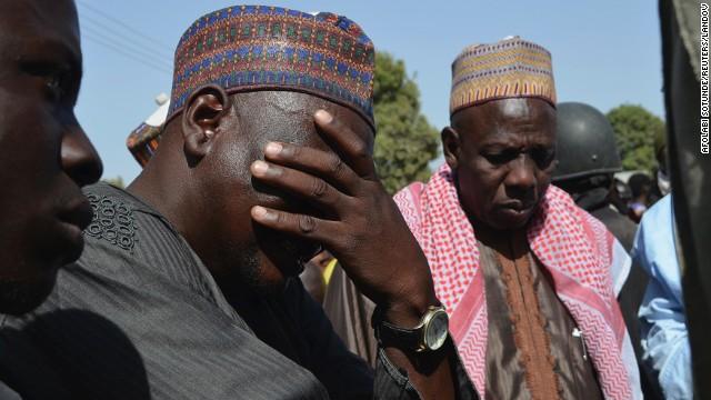 FILE: A man weeps at a meeting in Borno State in April called over previous abductions by insurgents.