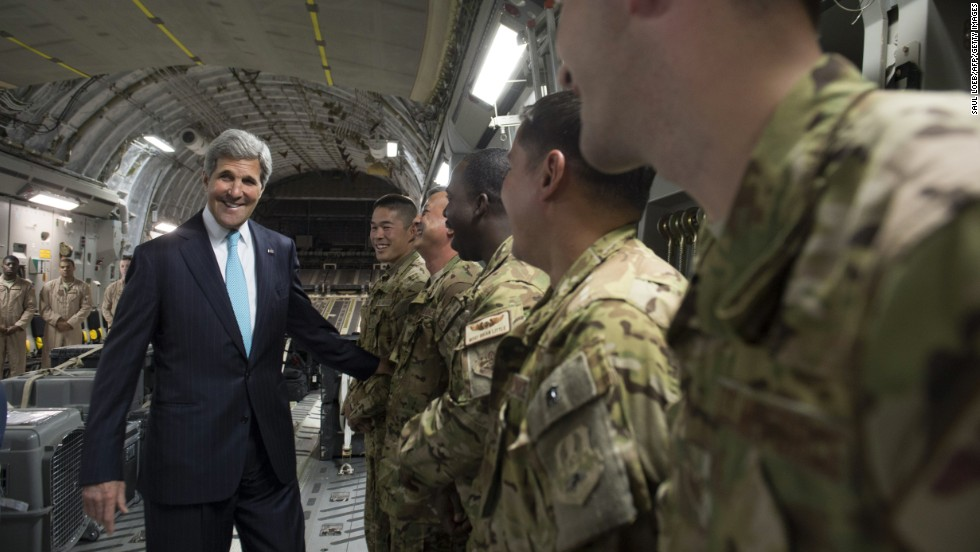 Kerry talks with the crew of a U.S. Air Force plane prior to departure from Addis Ababa, Ethiopia, on Friday, May 2,  2014. He was en route to Juba, South Sudan, to demand a cease-fire in the brutal civil war that has sparked dire warnings of genocide and famine.