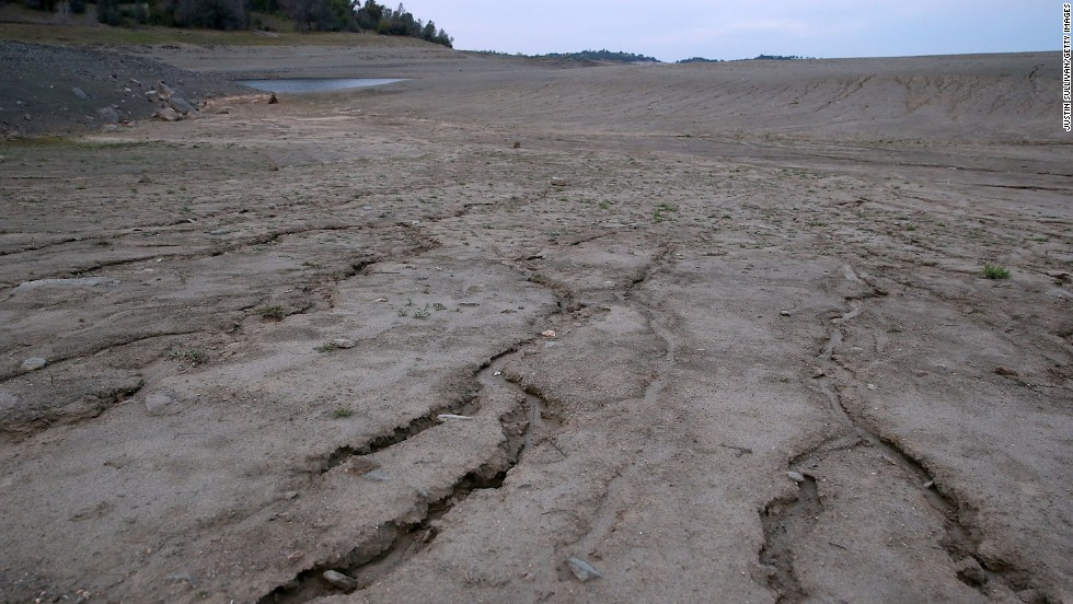 The Great Plains could experience heavier droughts and heat waves with increasing frequency, while more wildfires in the West could threaten agriculture and residential communities, the report notes. In this image, dry and cracked earth is visible on what used to be the bottom of Folsom Lake on March 20, in El Dorado Hills, California.
