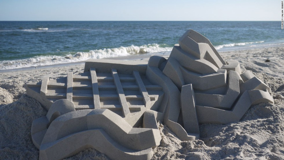 The texture of the sand is key to getting a strong structure and smooth finish. The ideal dampness is similar to the sand you'd find if you dug about 6 inches into the beach's sand.