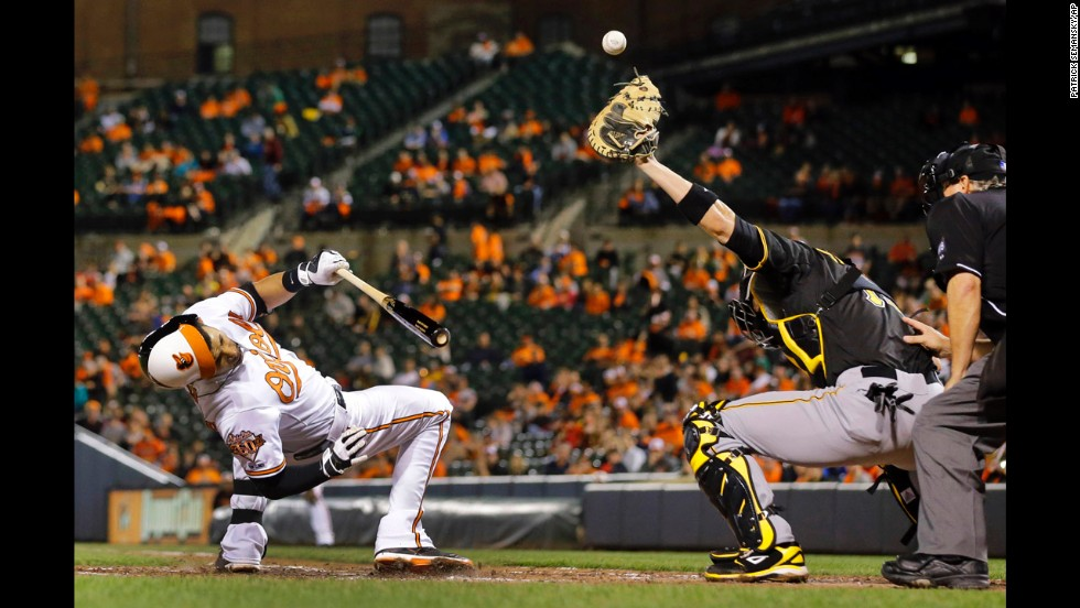 Baltimore's Manny Machado ducks Thursday, May 1, as Pittsburgh catcher Tony Sanchez tries to catch a wide pitch during a Major League Baseball game in Baltimore. Machado and the Orioles won both games of a doubleheader that day.