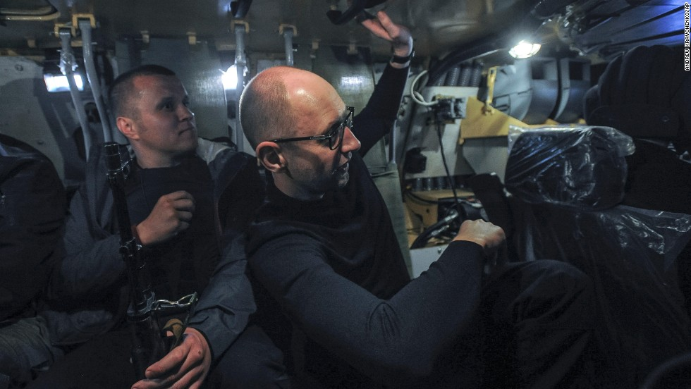 Ukrainian Prime Minister Arseniy Yatsenyuk, right, inspects an armored personnel carrier in Slovyansk on May 7.