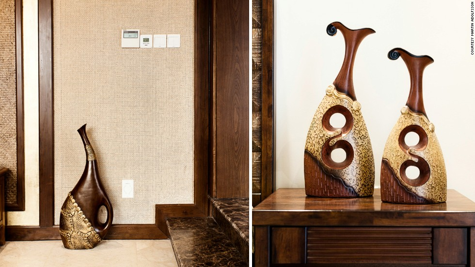 "Strikingly similar furniture and sculpture at separate suburban show homes in the Sheshaun Yinhu Noble Villa in Shanghai, China (left), and the Southridge complex in Bangalore, India (right). <br /><br />""It was interesting in that the homes themselves were very similar but the surrounding cultural community (outside of the gates) was very different,"" Adolfsson said.<br /><br />""The people living in these enclaves seem to have more in common with each other than they do with their fellow citizens living outside the gated community."" <br /><br />""I think that's really what's interesting. It's almost like you have these small isolated islands of prosperity. They seem to strive for the same things as other people in these enclaves in other emerging countries."""