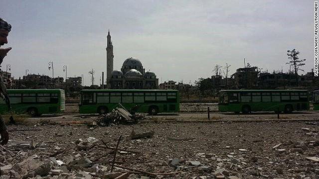 Rebels begin evacuation of Homs