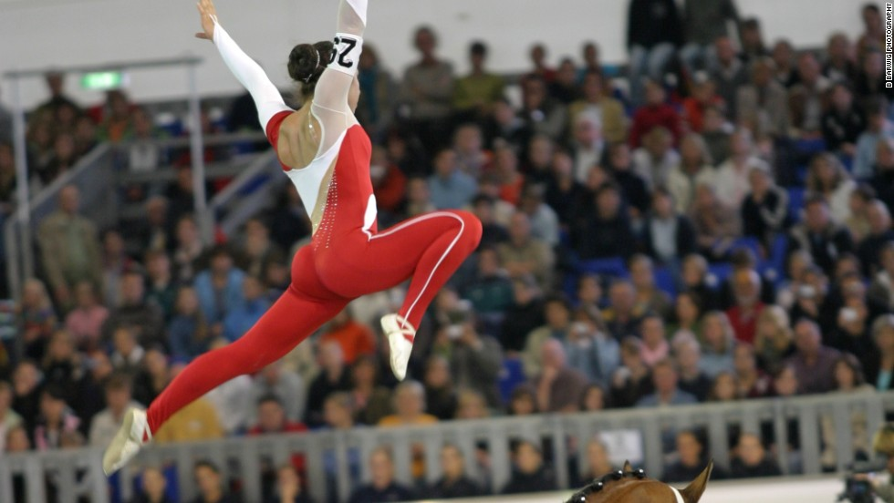 Benjamin performs a split leap. Vaulting's trickiest move may be the shoot-up mount, where the vaulter springs onto the horse while facing its tail, using a combined backflip and reverse-handstand motion.
