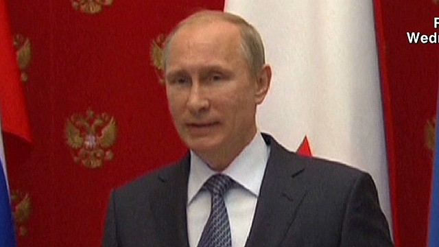 Putin claims troops moved from border