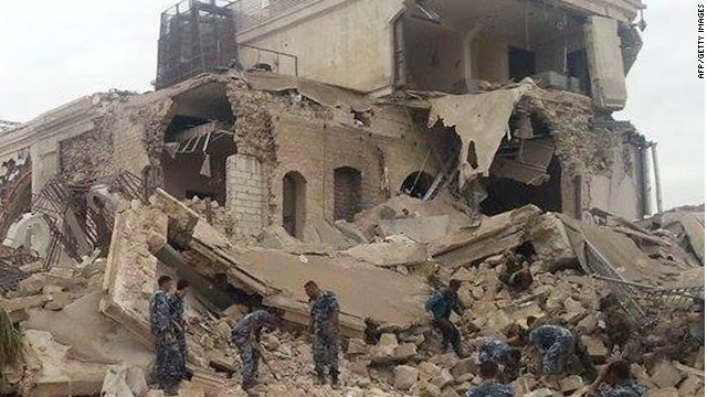 Syrian government forces sift through the rubble.