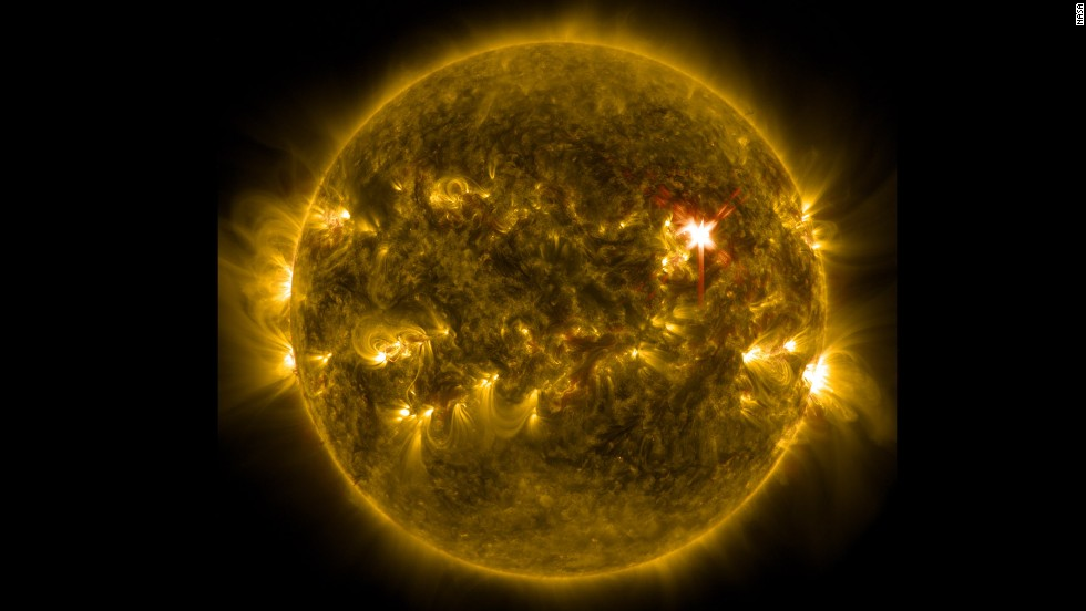 Extreme ultraviolet light streams out of an X-class solar flare in this image captured by NASA's Solar Dynamics Observatory. The image, captured in March and released Wednesday, May 7, blends two wavelengths of light to help scientists observe the lower levels of the sun's atmosphere.