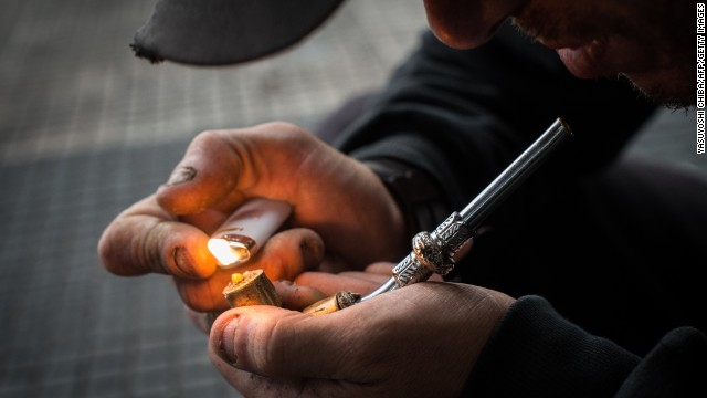 Another city, another Cracolandia: An addict lights an improvised pipe in downtown Sao Paulo.