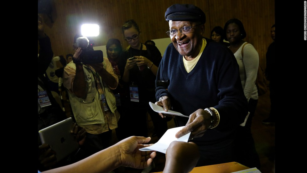 Archbishop Desmond Tutu receives his ballot papers before voting in South Africa's election Wednesday, May 7, in Cape Town. It is the country's first election since Nelson Mandela's death and the fifth since the end of apartheid in 1994.
