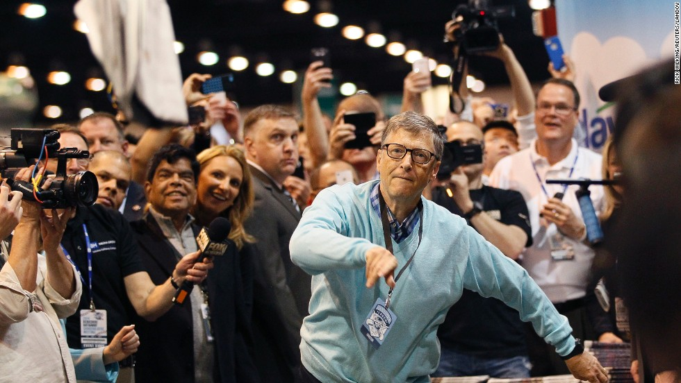 Microsoft founder Bill Gates competes in a newspaper-throwing competition Saturday, May 3, at the Berkshire Hathaway annual meeting in Omaha, Nebraska.