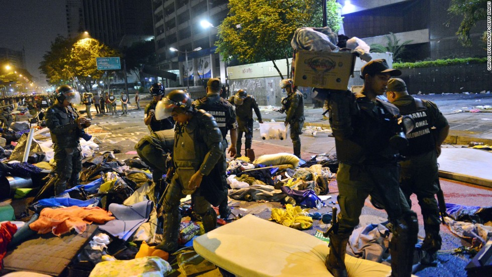 Venezuelan riot police stormed four encampments of opposition students on Thursday, May 8, across Caracas, including one in front of the United Nations headquarters in the capital city, detaining hundreds.