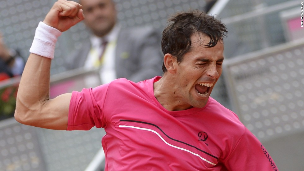 Santiago Giraldo shows his delight at his straight sets victory over Andy Murray to reach the last eight of the Madrid Masters.