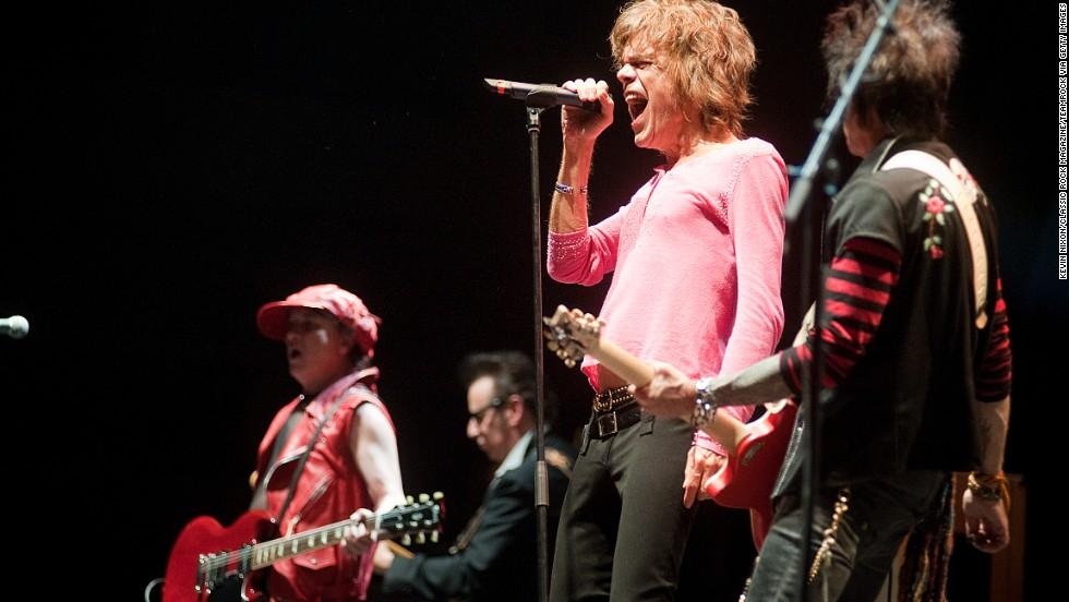 "The New York Dolls formed in 1971, and helped drive the punk movement. According to The Rolling Stone Encyclopedia of Rock & Roll, their cross-dressing ""captured the outrage and threat of glam."" However, tragedy hit the group when drummer Billy Murcia died after suffocating when he mixed alcohol and pills in the band's first England tour. The band played support for Alice Cooper in 2011. Here, the New Yorks Dolls' David Johansen performs at London's Alexandra Palace on October 29, 2011."