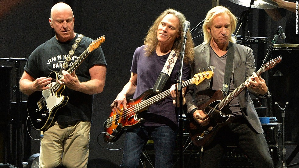 "The Eagles emerged in the early 1970s from Los Angeles, and have sold more than 100 million albums. The Eagles ""Their Greatest Hits"" album went platinum and is one of the biggest selling in the U.S. The band broke up in 1980 but reunited in the mid 1990s with a successful tour, and were inducted into the Rock and Roll Hall of Fame in 1998. Here, Bernie Leadon, Timothy B. Schmit and Glen Frey of the Eagles perform during ""History Of The Eagles Live In Concert"" at the Bridgestone Arena on October 16, 2013 in Nashville, Tennessee."