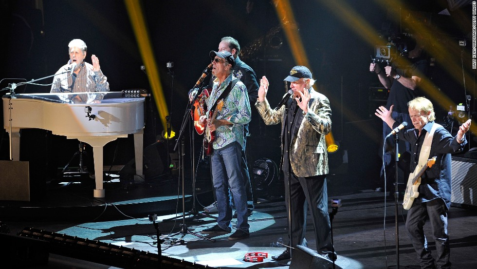 "The Beach Boys, known as the band who invented California Rock, emerged in the early 1960s after brothers Brian, Carl and Dennis Wilson began churning out easy pop hits like ""Surfin Safari"" and ""Surfin U.S.A.,"" about the West Coast life. They were inducted into the Rock and Roll Hall of Fame in 1988. Here, Brian Wilson, David Marks, Mike Love and Al Jardine of The Beach Boys perform at the Royal Albert Hall on September 27, 2012 in London, England."