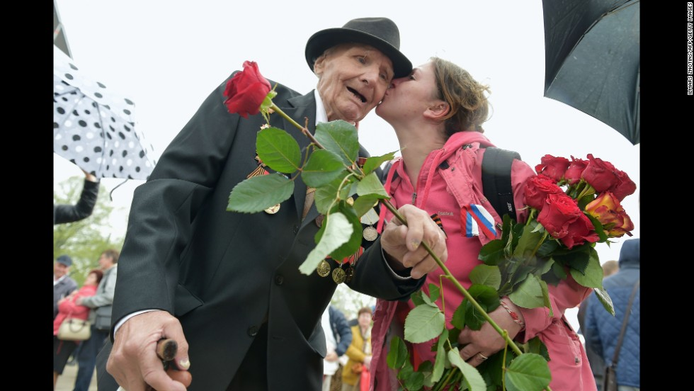 A woman kisses a World War II veteran in Riga, Latvia, on Friday, May 9, as the country's large Russian minority gathered to celebrate Victory Day, the anniversary of Nazi Germany's surrender to the Soviet Union.