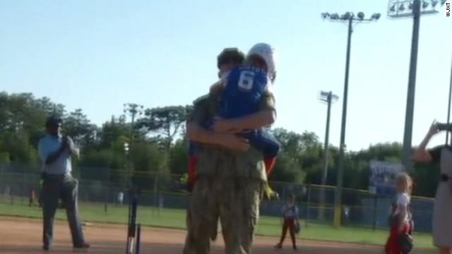 pkg soldier surprises daughter at softball game_00003208.jpg