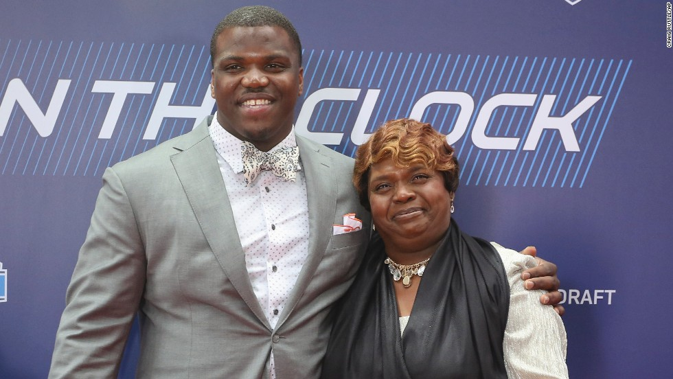 Greg Robinson, an offensive tackle from Auburn who went second overall to the St. Louis Rams, poses with his mother, Rhonda.