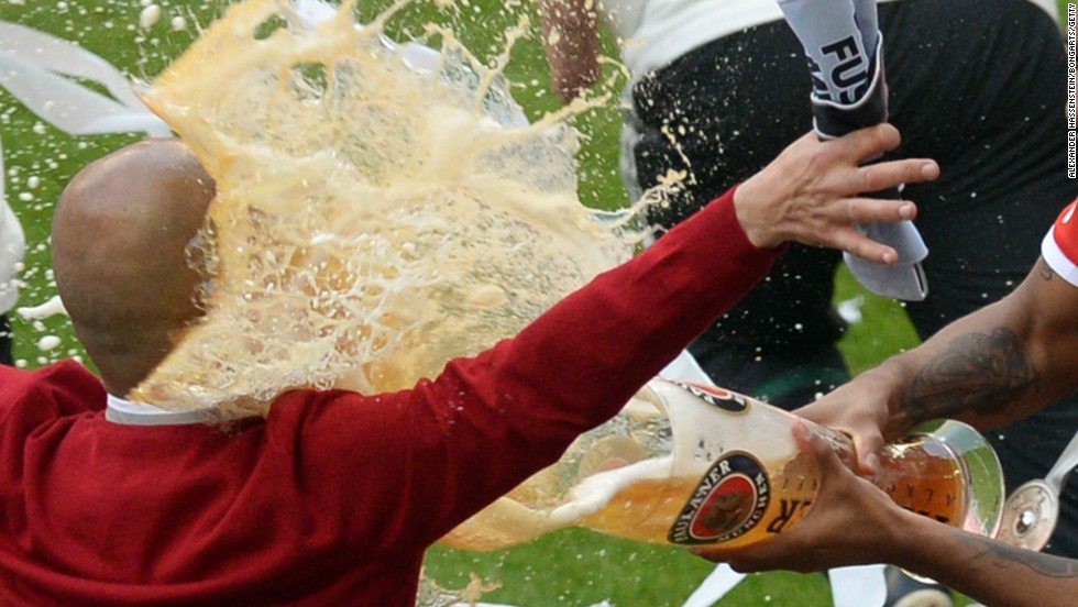Bayern boss Pep Guardiola receives the traditional beer shower as his side celebrate a 24th Bundesliga title.
