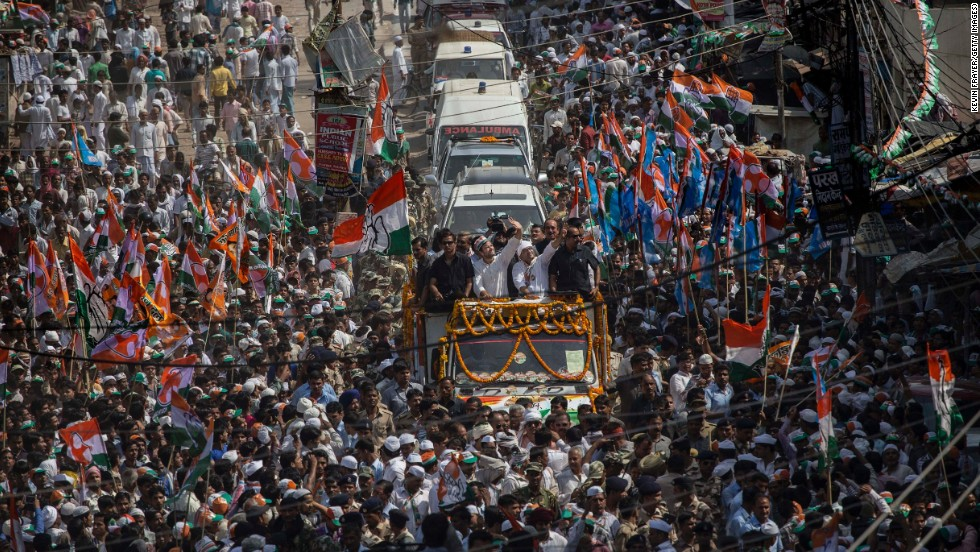 "The Indian National Congress party's Rahul Gandhi, center, waves to supporters at a rally in Varanasi on Saturday, May 10, the final day of campaigning in <a href=""http://www.cnn.com/2014/04/06/opinion/bergen-india-elections-11-things/"">India's national election</a>. There are 814 million eligible voters in India, making this the largest election in world history."