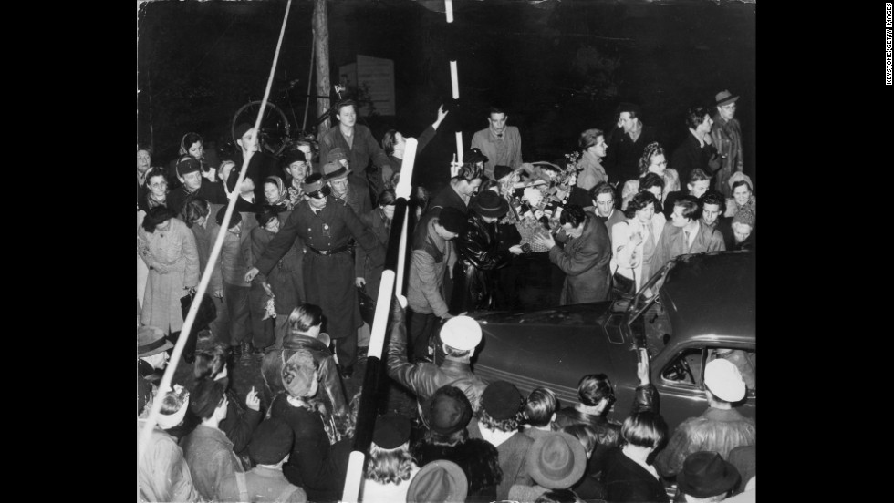 Barriers are raised for one of the first cars to arrive in Berlin after the blockade is lifted.