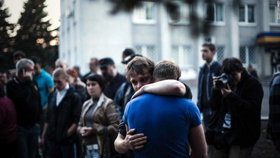 Two men react after Ukrainian national guardsmen open fire on a crowd outside a town hall in Krasnoarmiysk, Ukraine, on May 11.