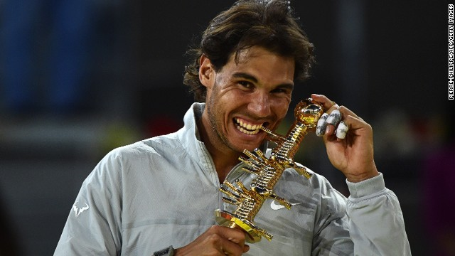 Rafael Nadal poses with the 2014 Madrid Masters trophy.