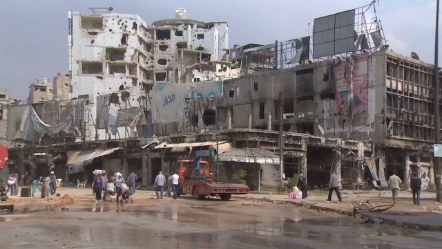 Cleanup starts in Homs after truce