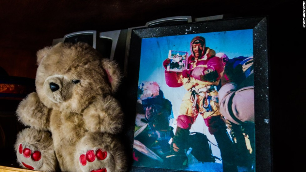 "A photograph of Ang Tshiring's son, Pemba Sherpa, atop Mount Everest holding a picture of his family. ""I've summited Everest 14 times and I always brought a photograph of my family with me,"" he says."