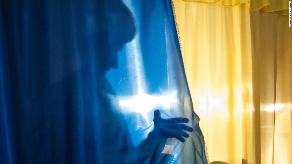 "A person leaves a voting booth in Luhansk, Ukraine, on May 11. The Donetsk and Luhansk regions of eastern Ukraine voted on controversial referendums to declare independence from the government in Kiev. Acting Ukrainian President Oleksandr Turchynov called the vote ""propagandist farce."""